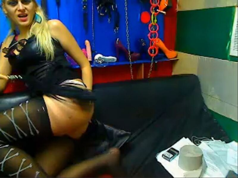 Screenshot of Kinky Blonde Fingering Her Ass